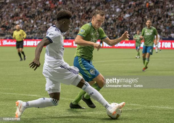 Alphonso Davies of the Vancouver Whitecaps and Brad Smith of the Seattle Sounders at BC Place on September 15 2018 in Vancouver Canada