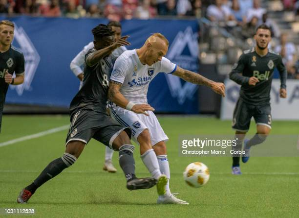 Alphonso Davies of the Vancouver Whitecaps and Magnus Eriksson of the San Jose Earthquakes battle for the ball at BC Place on September 1 2018 in...
