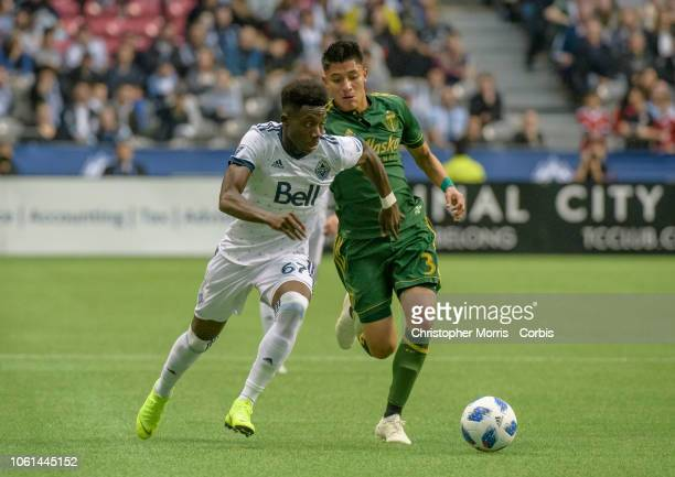 Alphonso Davies of the Vancouver Whitecaps and Marco Farfan of the Portland Timbers at BC Place on October 28 2018 in Vancouver Canada