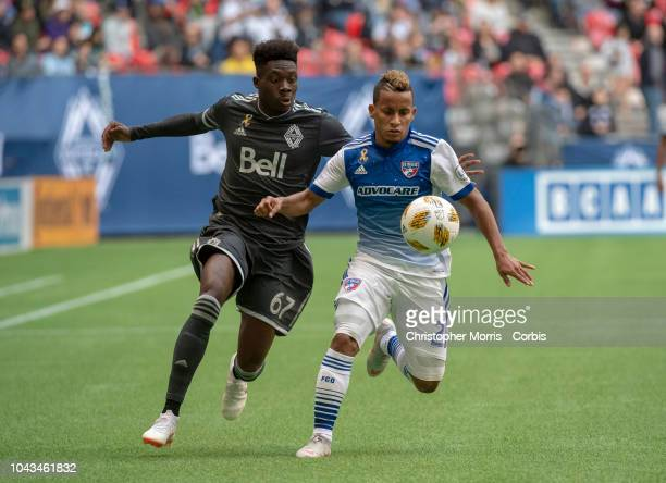 Alphonso Davies of the Vancouver Whitecaps and Michael Barrios of FC Dallas at BC Place on September 23 2018 in Vancouver Canada