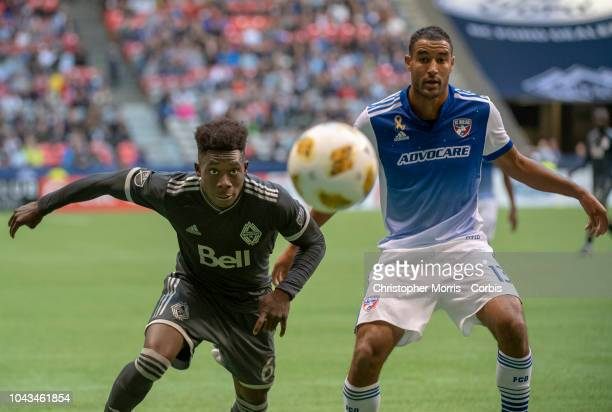 Alphonso Davies of the Vancouver Whitecaps and Tesho Akindele of FC Dallas at BC Place on September 23 2018 in Vancouver Canada