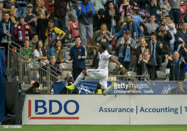 Alphonso Davies of the Vancouver Whitecaps celebrates his first goal against the the Portland Timbers at BC Place on October 28 2018 in Vancouver...