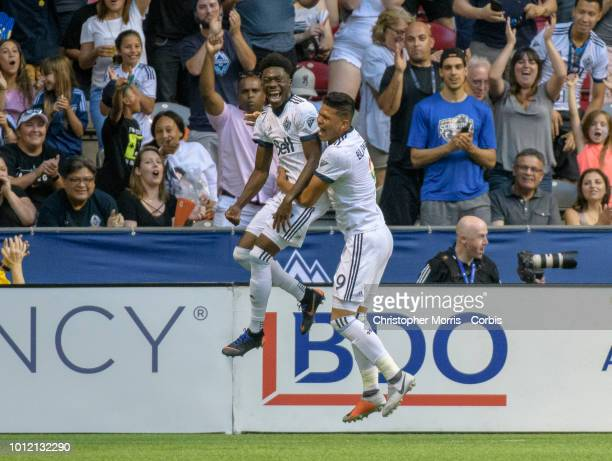 Alphonso Davies of the Vancouver Whitecaps celebrates his goal against Minnesota United with teammate Anthony Blondell of the Vancouver Whitecaps at...