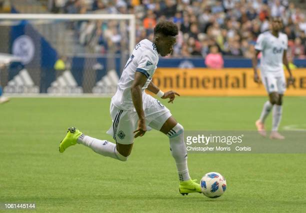 Alphonso Davies of the Vancouver Whitecaps controls the ball against the Portland Timbers at BC Place on October 28 2018 in Vancouver Canada