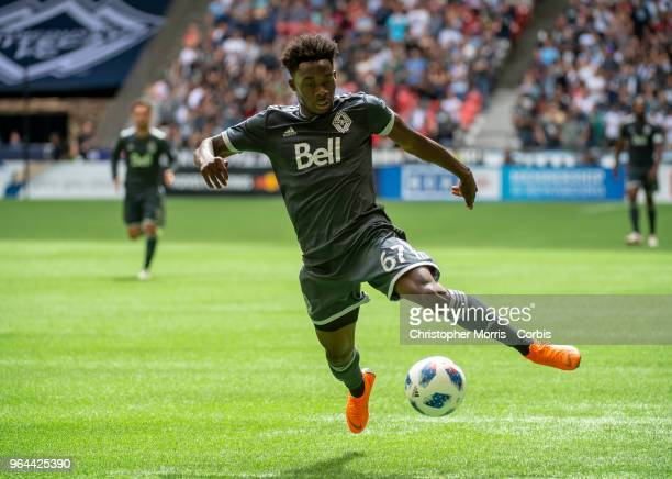 Alphonso Davies of the Vancouver Whitecaps controls the ball against New England Revolution at BC Place on May 26, 2018 in Vancouver, Canada.