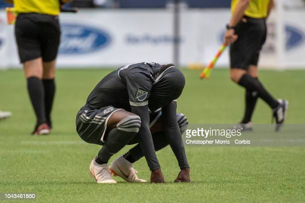 Alphonso Davies of the Vancouver Whitecaps covers his head in his jersey after Vancouver's loss to FC Dallas at BC Place on September 23 2018 in...