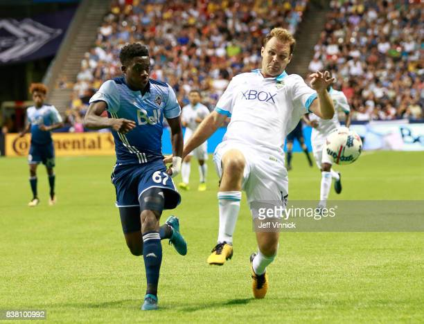 Alphonso Davies of the Vancouver Whitecaps FC and Chad Marshall of the Seattle Sounders watch a loose ball during their MLS game August 23 2017 at BC...