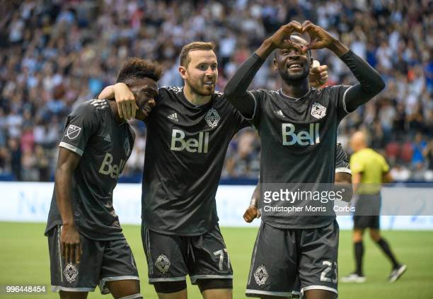 Alphonso Davies of the Vancouver Whitecaps FC Jordon Mutch of the Vancouver Whitecaps FC and Kei Kamara of the Vancouver Whitecaps FC celebrate...