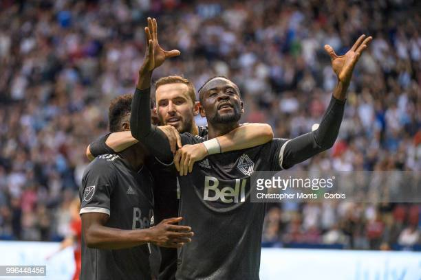 Alphonso Davies of the Vancouver Whitecaps FC , Jordon Mutch of the Vancouver Whitecaps FC and Kei Kamara of the Vancouver Whitecaps FC celebrate...