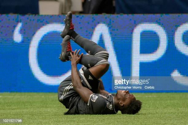 Alphonso Davies of Vancouver Whitecaps rolls on the ground after an illegal tackle against him at BC Place on August 18 2018 in Vancouver Canada