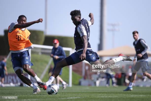 Alphonso Davies shoots the ball past David Alaba during day three of the FC Bayern Muenchen winter training camp at Aspire Academy on January 06 2020...