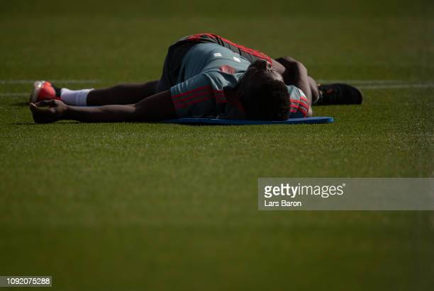 Alphonso Davies streches during a training session at day seven of the Bayern Muenchen training camp at Aspire Academy on January 07 2019 in Doha...