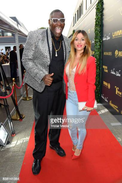 Alphonso Williams and Guelcan Kamps attend the 'Michalides Zahn Werder Klinik' Opening on August 23 2017 in Bremen Germany