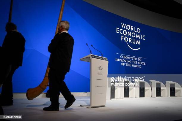 Alphorn blowers leaves the stage during the opening of the World Economic Forum annual meeting on January 22 2019 in Davos eastern Switzerland
