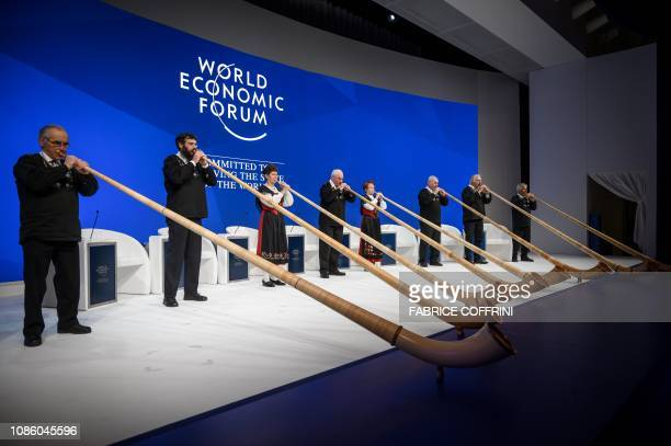Alphorn blowers perform during the opening of the World Economic Forum annual meeting on January 22 2019 in Davos eastern Switzerland