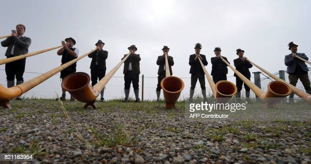 Alphorn blowers play their instruments during the socalled 'Berglar Kirbe' outdoor church service dedicated to Saint Jakobus on the Fellhorn mountain...