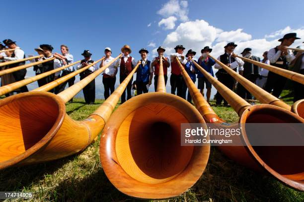 Alphorn players perform on July 28 2013 in Nendaz Switzerland About 150 alphorn blowers performed together on the last day of the international...
