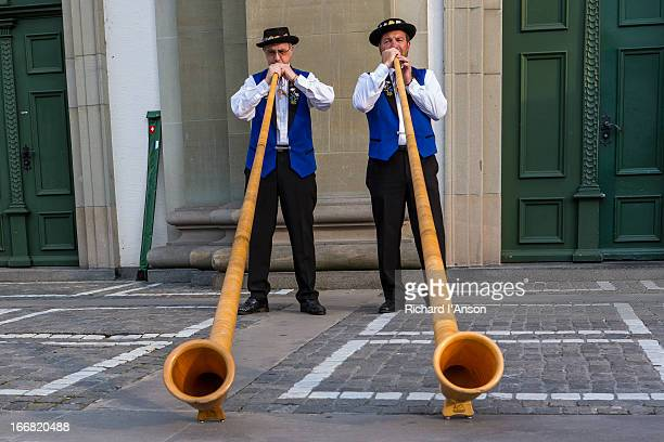 Alphorn players performing outside Jesuit Church