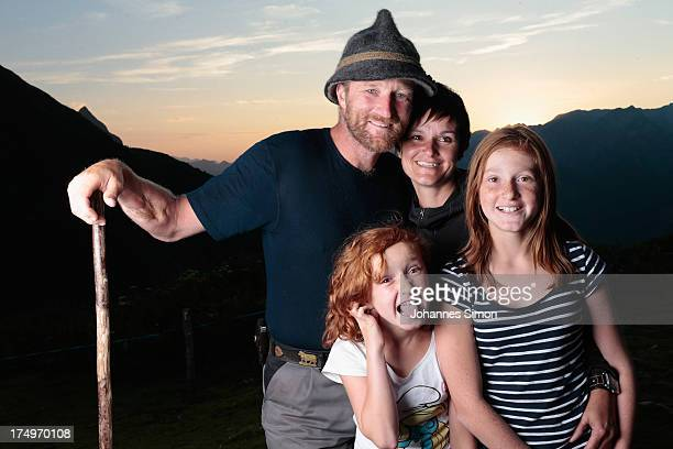 Alpine cattle herder Martin Riedmann his wife Veronica and their daughters Selina and Sabrina pose for a picture in front of alpine dairy Alpe Albona...