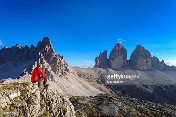Alpine climber look to Three pinnacles, European Alps