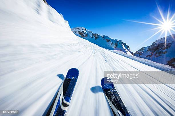 Alpine downhill skiing on sunny day