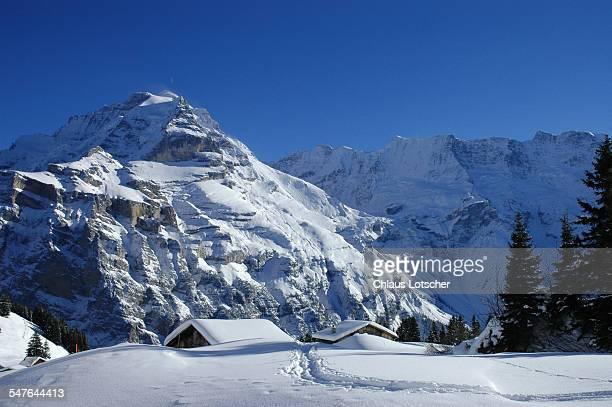 Alpine huts in snow, Mürren, Bernese alps