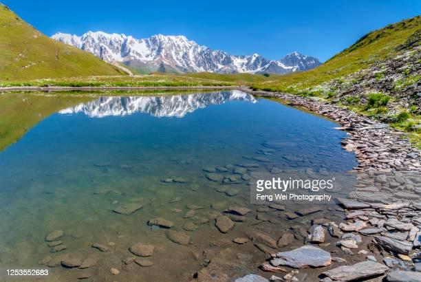 alpine lake in caucasus mountains, latpari pass, upper svaneti, georgia - コーカサス山脈 ストックフォトと画像