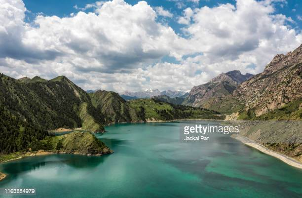 alpine lake in west china - tien shan mountains stock pictures, royalty-free photos & images