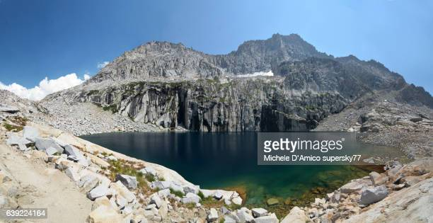 alpine lake surrounded by vertical granite cliffs in the high sierra - sequoia national park stock photos and pictures