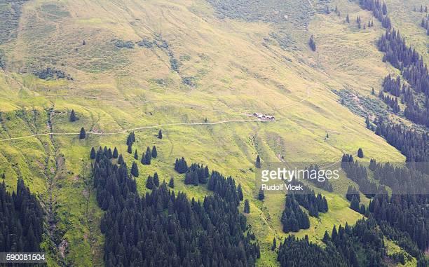 Alpine landscape with cottage on a steep hillside