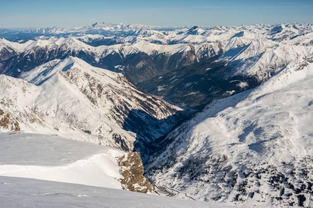 Alpine panorama in winter, Gastein valley with Bad Gastein in the foreground, on the right Skiareal Kreuzkogel 2686 m, ski region Gasteinertal- Ski amade, Dachstein massif in the back, Bad Gastein, Land Salzburg, Austria