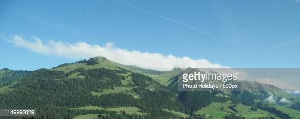 alpine panorama seen from european gruyeres town in switzerland on august - leah wilde stock-fotos und bilder