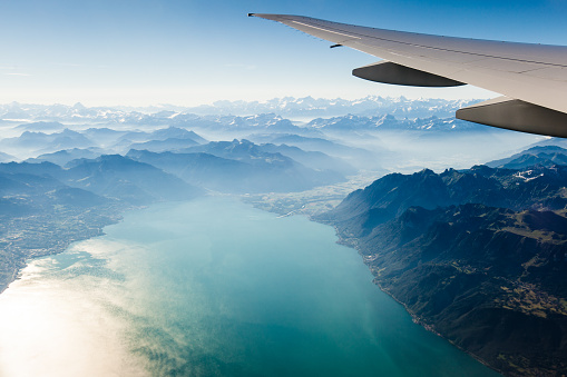 Alpine scenery from the air through the airplane window 900763322