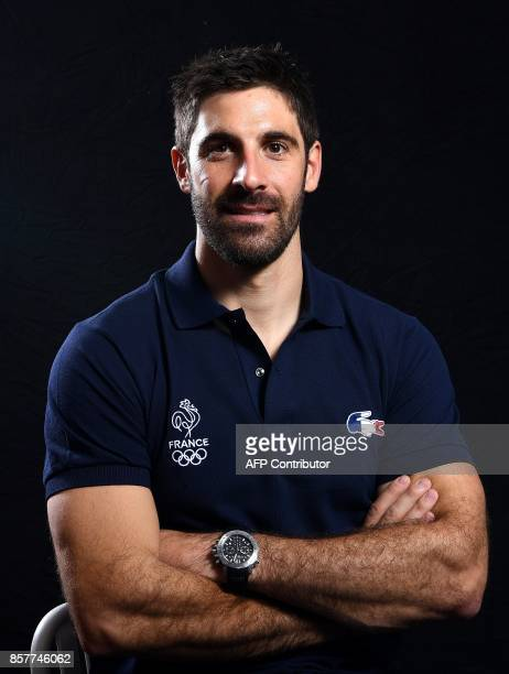 Alpine ski racer Adrien Theaux poses on October 4 2017 in Paris during the presentation of the French delegation to the Winter Olympic Games in...
