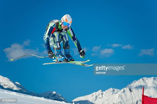 Alpine Skier Jumping During the Straight Downhill Race