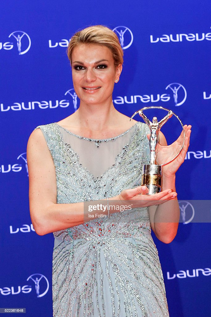 Alpine skier Maria Hoefl-Riesch poses with the trophy during the Laureus World Sports Awards 2016 on April 18, 2016 in Berlin, Germany.
