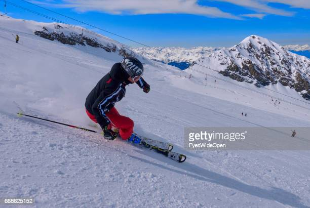 Alpine skiers and snowboarder enjoy the powder snow on the glacier of Hintertux on March 12 2017 in Hintertux Austria