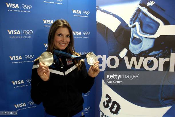 Alpine skiier Julia Mancuso of the United States poses with her medals after participating in a VISA Athlete Panel on February 26 2010 in Vancouver...