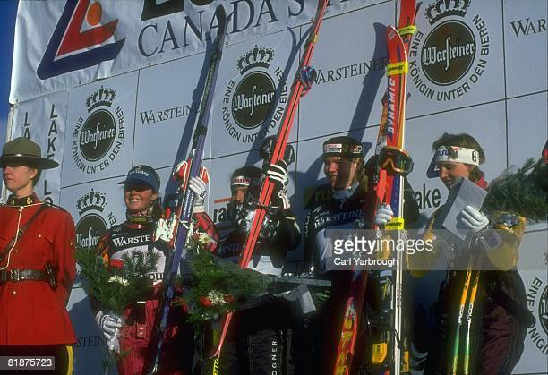 Alpine Skiing World Cup USA Picabo Street and DEU Katja Seizinger victorious with others at awards ceremony after downhill competition Lake Louise...