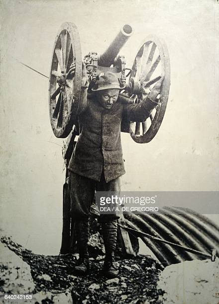 Alpine soldier with a mortar on his back during the First World War photograph Museum of the Alpini Biella Piedmont Italy Biella Museo Del Territorio...