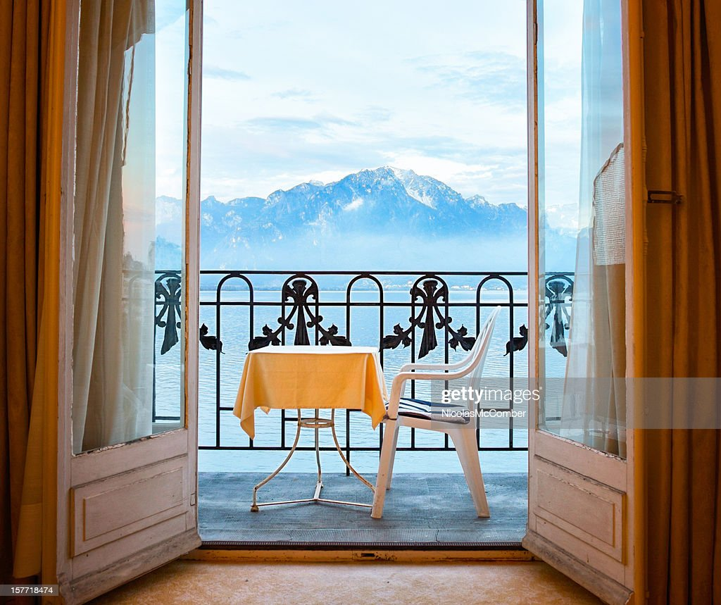 French doors stock photos and pictures getty images alpine view with balcony and open french doors rubansaba