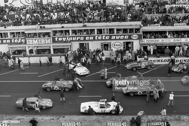 AlpineRenault A210 Ford GT40 Porsche 906LE Ferrari 365P2/3 Ford MkII 24 Hours of Le Mans Le Mans 19 June 1966 Cars being pushed on the starting grid...