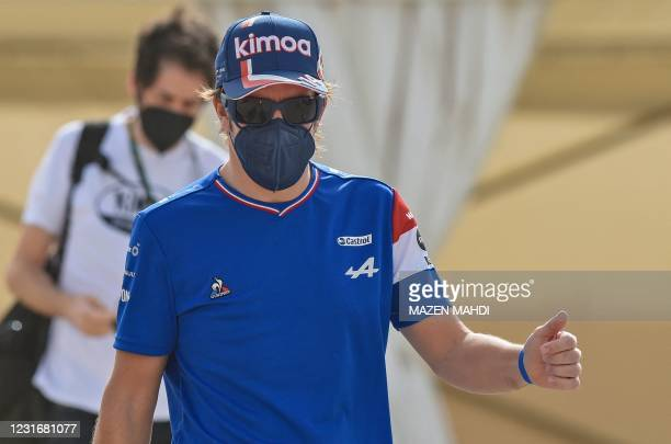 Alpine's Spanish driver Fernando Alonso arrives for the second day of the Formula One pre-season testing at the Bahrain International Circuit in the...