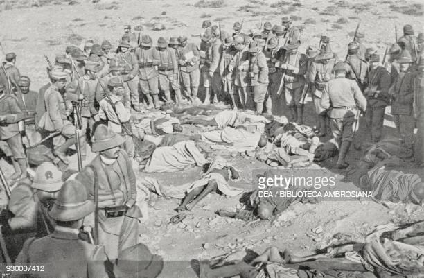 Alpini around the bodies of the Bedouin fallen during combat on 11 February 1912 at the Lombardia redoubt Derna Libya ItalianTurkish war photograph...
