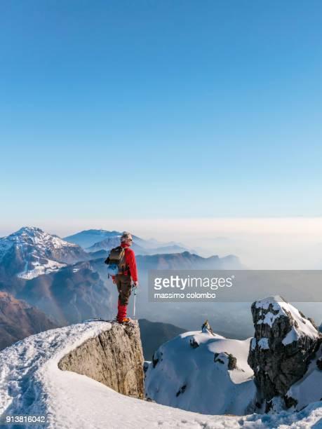 Alpinist enjoy mountain view on the top