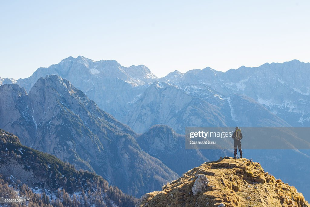 Alpinist Enjoying the View Over the Mountains in the Alps : Stock Photo