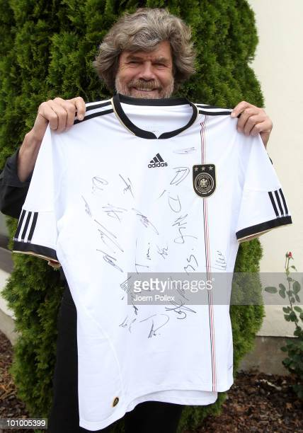 Alpinist Reinhold Messner poses with a signed jersey of the german team at Sportzone Rungg on May 27 2010 in Appiano sulla Strada del Vino Italy