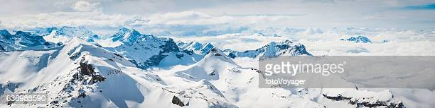 alps above the clouds snowy summits alpine peaks panorama switzerland - panorama stock-fotos und bilder