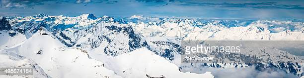 Alps aerial panorama over jagged mountain peaks snowy summits Switzerland