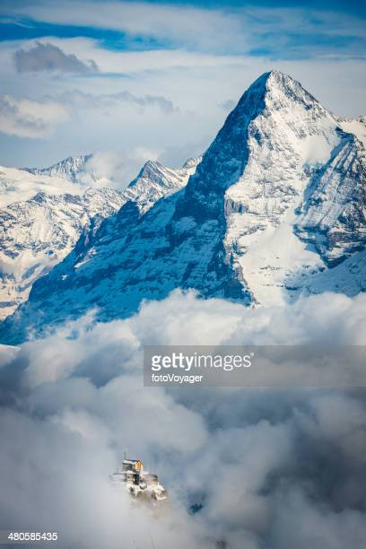 Alps Birg cable car station through clouds below Eiger Switzerland